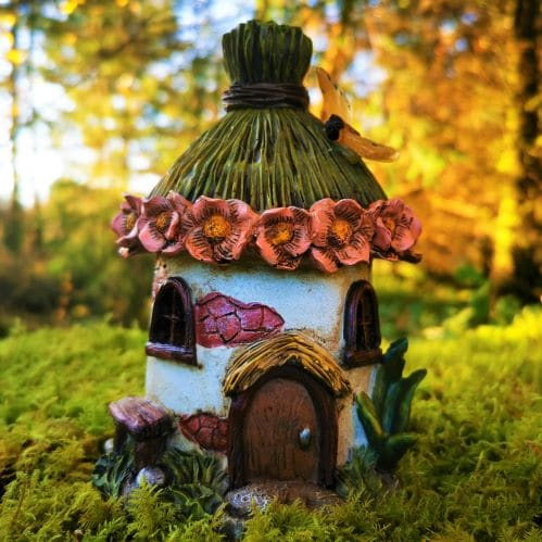 thatched solar fairy houses