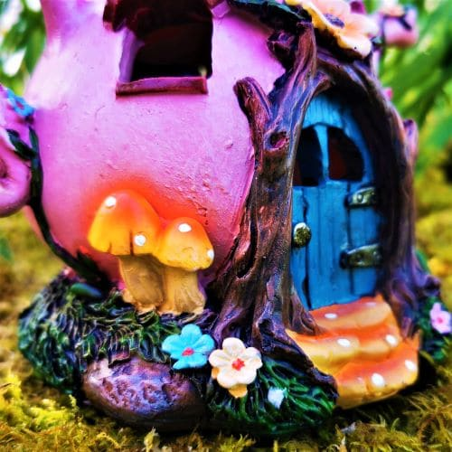 pink teapot fairy house