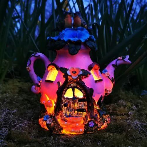 pink solar teapot fairy house