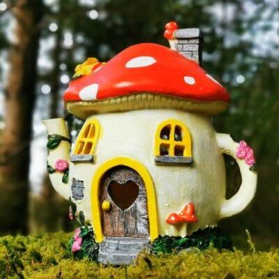 solar teapot fairy house