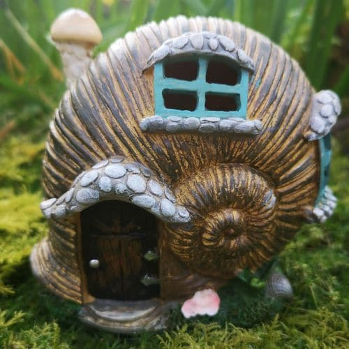 snail shell fairy house