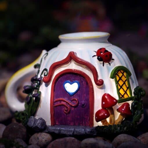 teacup fairy house at night