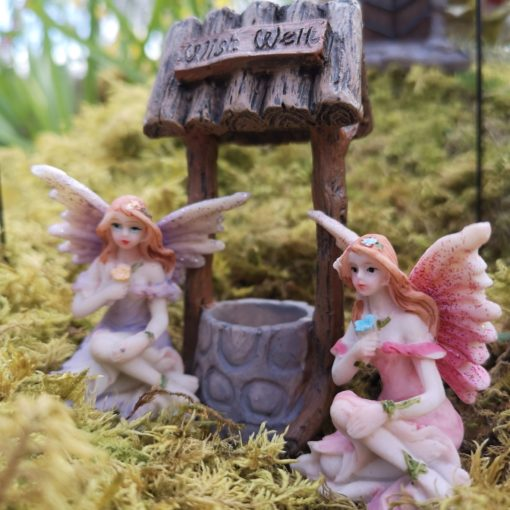 fairy figures and a wishing well