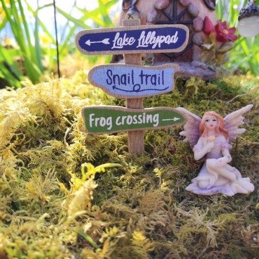 fairy garden signpost with figure