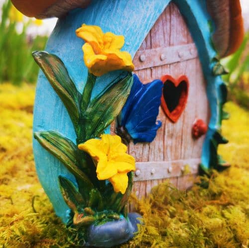flowers on the side of the fairy door