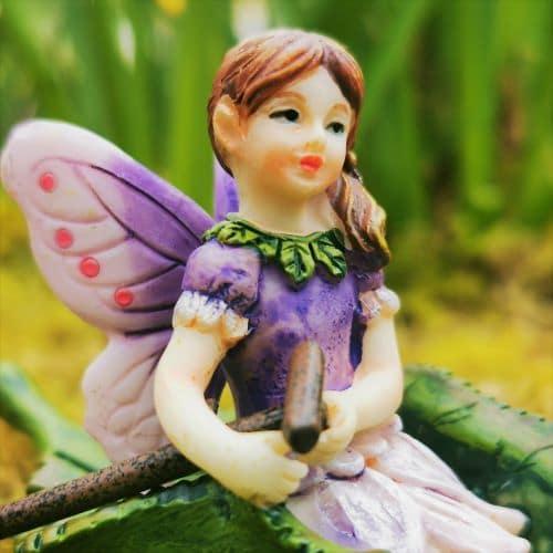 cute fairy in a boat