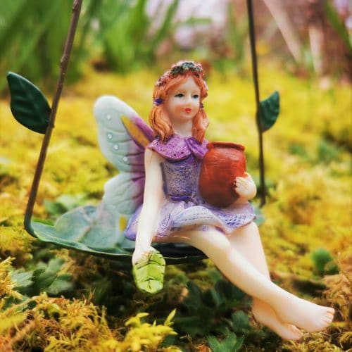 purple fairy on a swing