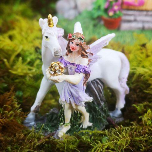 purple unicorn and fairy figurine