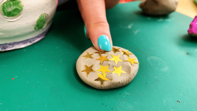 Press sequins into stepping stone