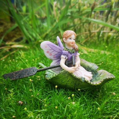 fairy and boat figurine