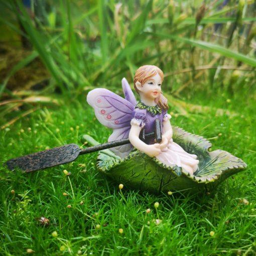 fairy and boat figurine