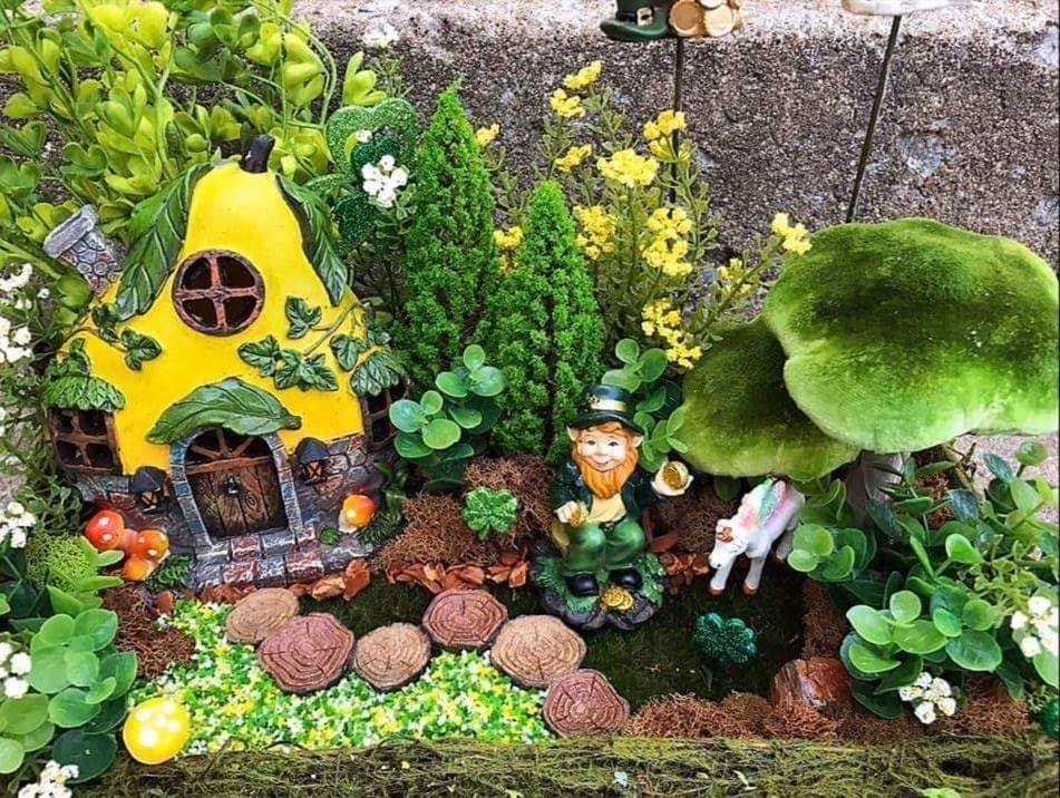a fairy gardening with kids example that uses saint patricks day fairy garden accessories
