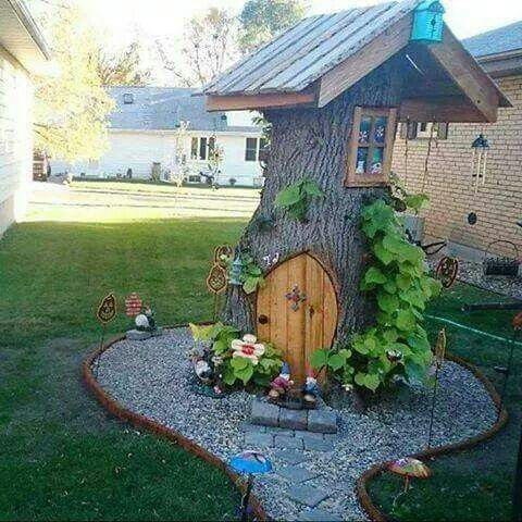 tree trunk fairy house in the garden