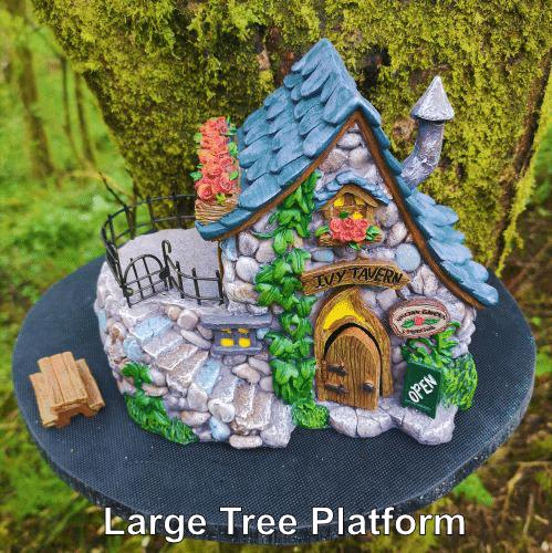 big fairy houses displayed on a tree platform