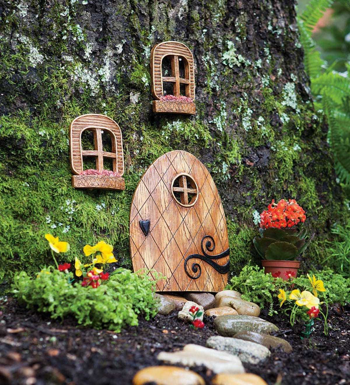 wooden fairy doors and windows fixed to trees