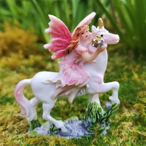 unicorn and fairy figurine