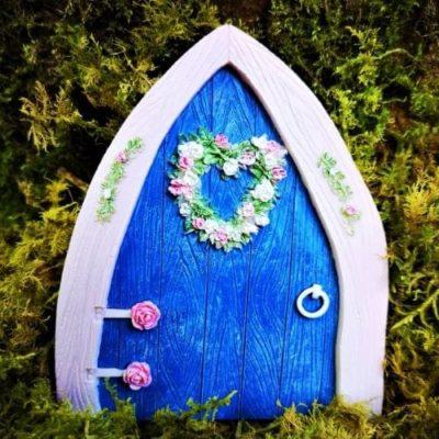 small blue fairy door for the garden