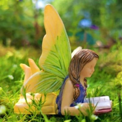 fairy figurine with book