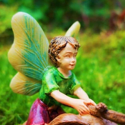 fairy boy figurine riding rabbit