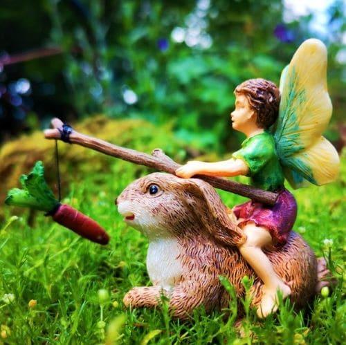 boy fairy ornament with rabbit