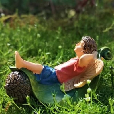 boy fairy figurine relaxing