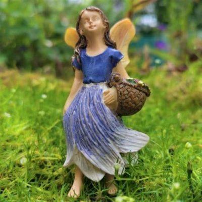 fairy girl gathering flowers figurine