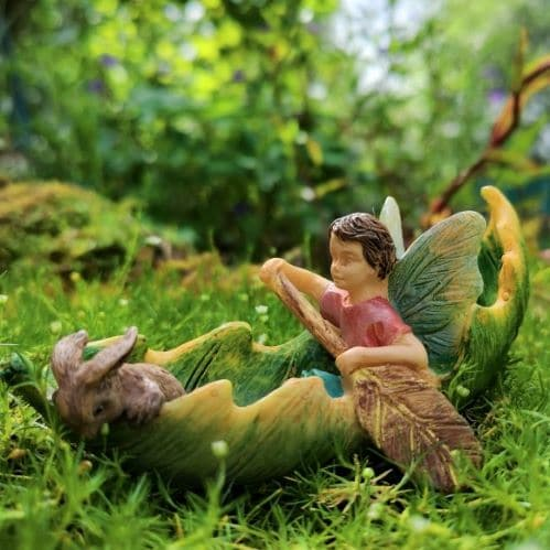 boy fairy figurine with boat