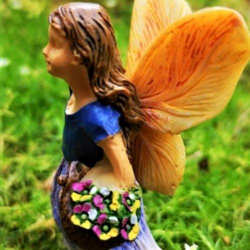 fairy figurine with purple dress