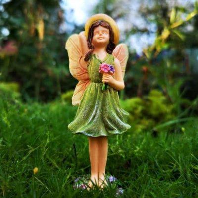 fairy with green dress figurine