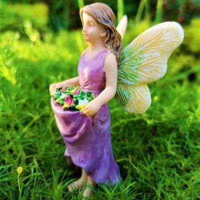 flower fairy figure with purple dress