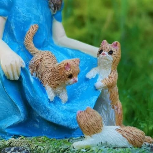 cats playing with the fairies skirt