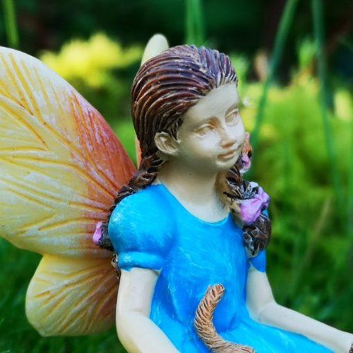 fairy figure with cat