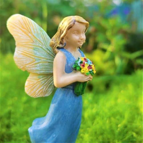 blue flower fairy figure