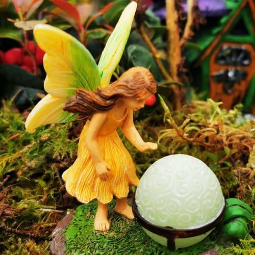 glowing orb fairy figure