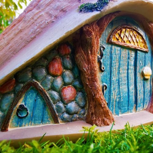two fairy doors on the shell house