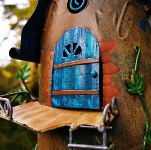 blue opening fairy door