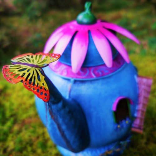 butterfly on teapot spout