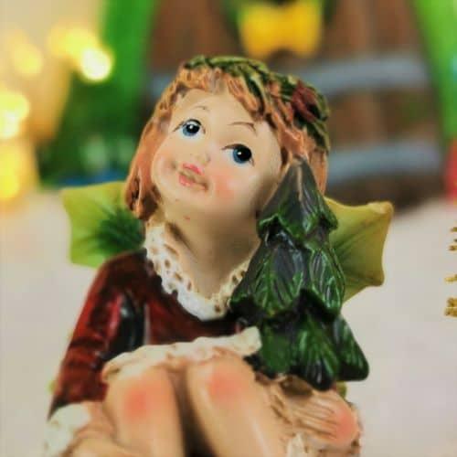 christmas fairy figure holly