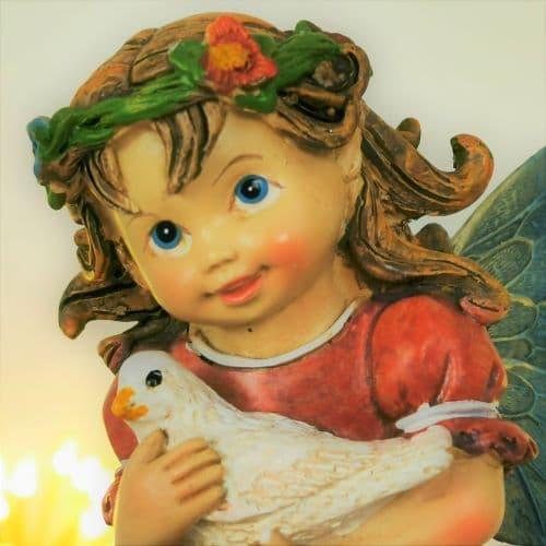 fairy figure with dove