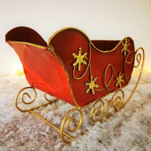 red metal sleigh ornament