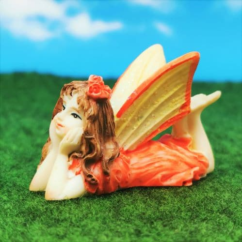 fairy figurine lying down