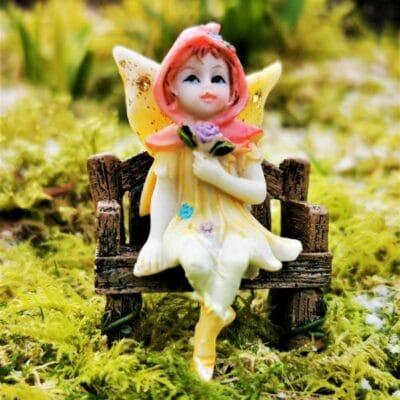 sitting yellow fairy