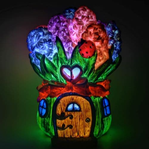 solar fairy garden house lit up