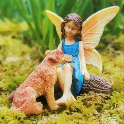 fairy and dog figurine