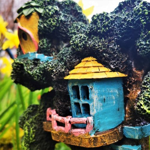 two fairy houses in a tree