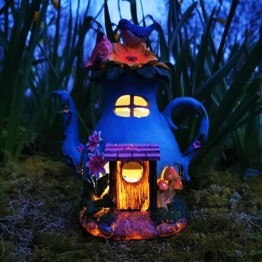 blue teapot fairy house