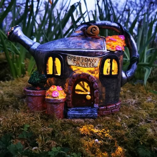 watering can fairy house at night