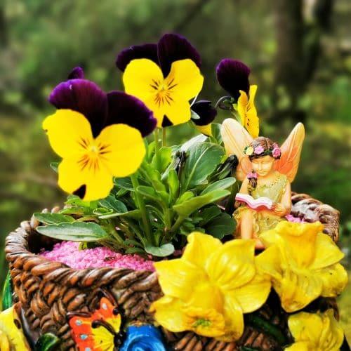 fairy figure in a planter