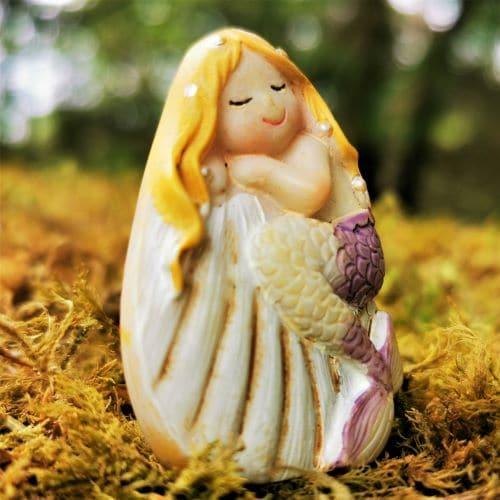 miniature mermaid statue
