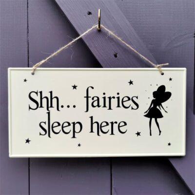 metal fairy sleeping sign
